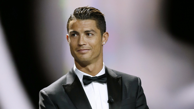 Real Madrid's Portuguese forward Cristiano Ronaldo stands on stage before receiving the UEFA European Best Player of the Year trophy, on August 28, 2014 in Monaco, after the draw for the 2014/2015 European Champions League group stages. AFP PHOTO / VALERY HACHE (Photo credit should read VALERY HACHE/AFP/Getty Images)